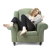 woman reading a book in armchair
