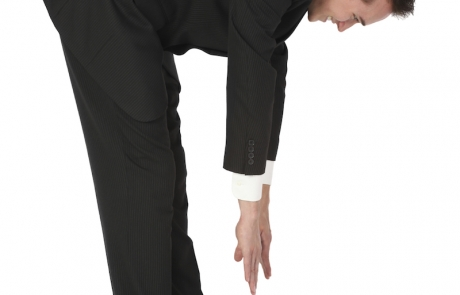 businessman touching toes - ws