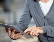 leader using digital tablet