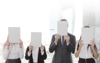 Business group holding white papers